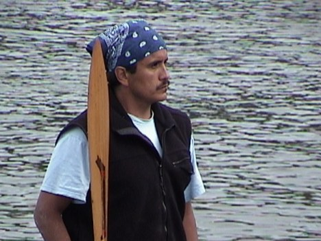 Quileute Skipper watches other canoes land