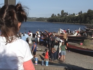 Child watches canoe landing