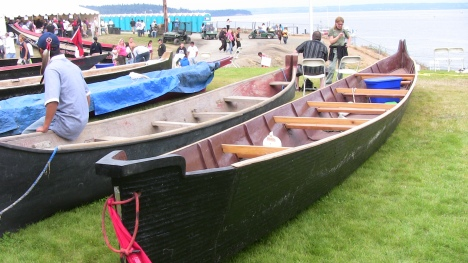 Canoes with people relaxing around them