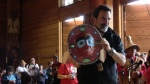 Suquamish Chairman receives mask for tribe.